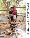 Small photo of Marble Village of Dhee Ayn / Saudi Arabia - January 20, 2020: Saudi father and son prepare picnic lunch while visiting Dhee Ayn Marble Village