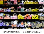 Small photo of The storage shelf girder perspective view of colorful metal stuff such as cast iron round bar, steel angle, metal pipe. They are raw materials of metalwork, construction for contractors or factory.