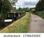 Long Black Narrow Boat Moored...