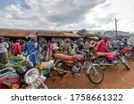 Small photo of Budadiri, Mbale, Uganda - February 14, 2020: Market day in a town in eastern Uganda where traders come from miles aground to sell vegetable and fruit produce in a typical African market.