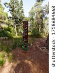 Small photo of Jerusalem, Israel, June 13, 2020 : A wooden post with explanatory inscriptions in Hebrew carved on it in the Totem park in the forest near the villages of Har Adar and Abu Ghosh