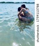 Two Sisters Having Fun In Lake...