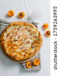 Small photo of Apricot pie. Apricot pizza, delicious and sweet. Homemade fruit pie (galette) made with fresh organic apricotes. Open pie, apricot tart. Fruit bakery. Summer pie.