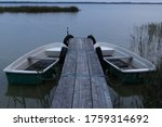 Two Rowing Boats On A Wooden...