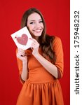 attractive woman with postcard  ... | Shutterstock . vector #175948232