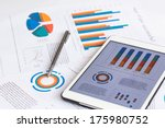 financial charts on the table... | Shutterstock . vector #175980752