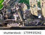 Artillery weapon. Old military cannon, closeup. Military background with elements of artillery weapons in camouflage green.
