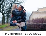 couple hugging in the park | Shutterstock . vector #176043926