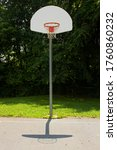 Small photo of Picture of a basketball post with hoop, breakaway rim, backboard and net