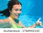Child Swims Underwater In...
