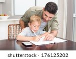 happy father helping son with... | Shutterstock . vector #176125202