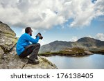 young man portrait with camera... | Shutterstock . vector #176138405