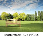 Garden Bench In Park With Trees