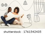 Young Black Couple Holding...