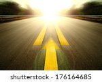 Small photo of Road With Painted Yellow arrow Line.