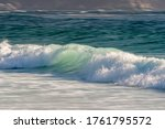 Breaking Wave Rolling Into The...