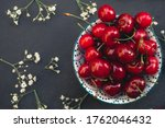 Red Ripe Cherries In A Round...