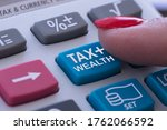 Small photo of Rich or wealth taxation concept with woman finger pressing tax button of pocket calculator