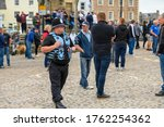 Small photo of Richmond, North Yorkshire, UK - June 14, 2020: A Police Liaison Officer at a Black Lives Matter protest