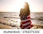 Girl With American Flag On The...