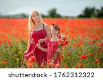 Mother And Daughter In Red...