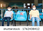 two asian kid wearing mask in... | Shutterstock . vector #1762438412