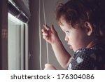 little kid on the window blinds ... | Shutterstock . vector #176304086
