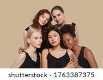 Small photo of The real beauty exists in every corner of the world and is presented by women of all races. Group portrait of five beautiful ladies in black tops and with different skin and hair colour.