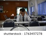 It is a picture of a male student with stress and complicated learning and headaches. His work failed. - stock photo