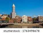 SEATTLE, USA - MARCH 29, 2020: Panoramic view of Smith Tower and Seattle cityscape at Elliott Bay in a sunny day, Washington, USA - stock photo
