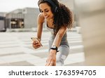 Fitness Woman Using An App On...