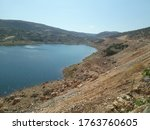 Lake And Rough Terrain View