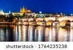 Prague night panorama. Prague Castle and Charles Bridge above Vltava River, Praha, Czech Republic. - stock photo