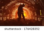 Silhouettes Of Workers In The...