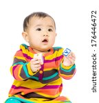 asia baby holding toy block | Shutterstock . vector #176446472