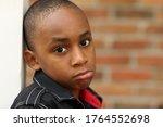 Sad Little Boy Portrait Outdoors
