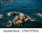 A Close Up Of A Rock Near The...