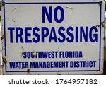 Blue No Trespassing Sign...