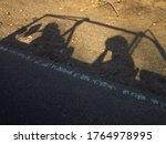 Shadow Of Two People Sitting I...