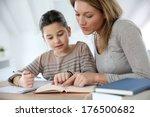 mom helping kid with homework | Shutterstock . vector #176500682