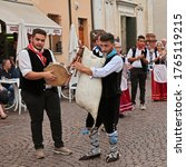 Small photo of Russi, Ravenna, Italy - August 2, 2015: musicians of folk ensemble Irizema from Bova Marina, Calabria, Italy, play tarantella with tambourine and Italian bagpipe zampogna during the Folklore Festival
