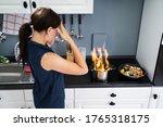 fire in kitchen. pot burning... | Shutterstock . vector #1765318175