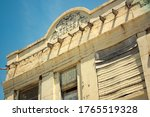 Facade of a dilapidated building from 1911 in Hollis Oklahoma