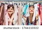 Small photo of Happy women at weekly flea market - Female friends having fun together shopping cloth on sunny day - Millenial lifestyle concept with girlfriends enjoying everyday life moments - Bright vivid filter