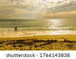 Young Man Surf Fishing On A...