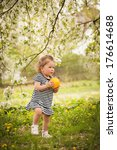 girl in the garden | Shutterstock . vector #176614688