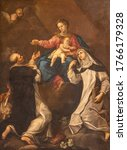 Small photo of RAVENNA, ITALY - JANUARY 28, 2020: The painting of Madonna with the St. Dominic and Catherine of Siena in church Basilica di Santa Maria del Porto by Andrea Barbiani from 18. cent.