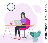 woman working at her desk at...