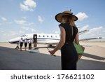 rear view of woman walking... | Shutterstock . vector #176621102