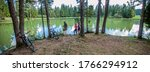 Small photo of A panoramic view of Lake Bloke surrounded with trees reflecting on the lake